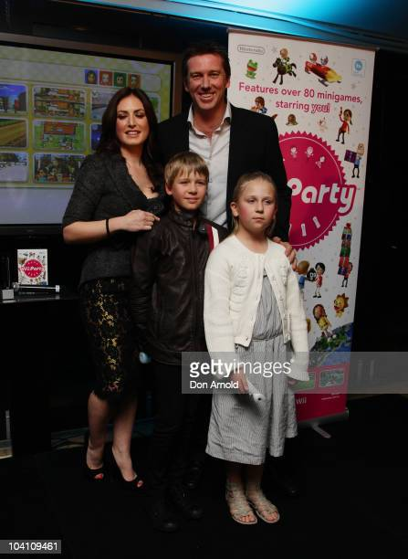 Nintendo ambassadors Glenn McGrath and Sara Leonardi pose alongside James McGrath and Holly McGrath during the offical Australian launch on September...