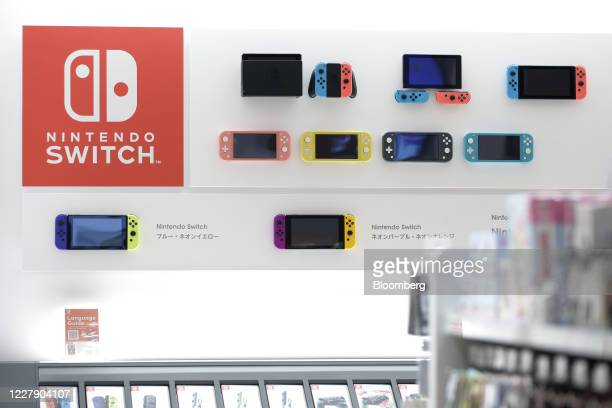 Nintendo Co. Switch game consoles and Switch Lite game consoles are displayed inside the Nintendo TOKYO store in Tokyo, Japan, on Tuesday, Aug. 4,...