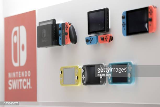 Nintendo Co Switch game consoles top and Switch Lite game consoles are displayed inside the Nintendo TOKYO store during a media tour in Tokyo Japan...