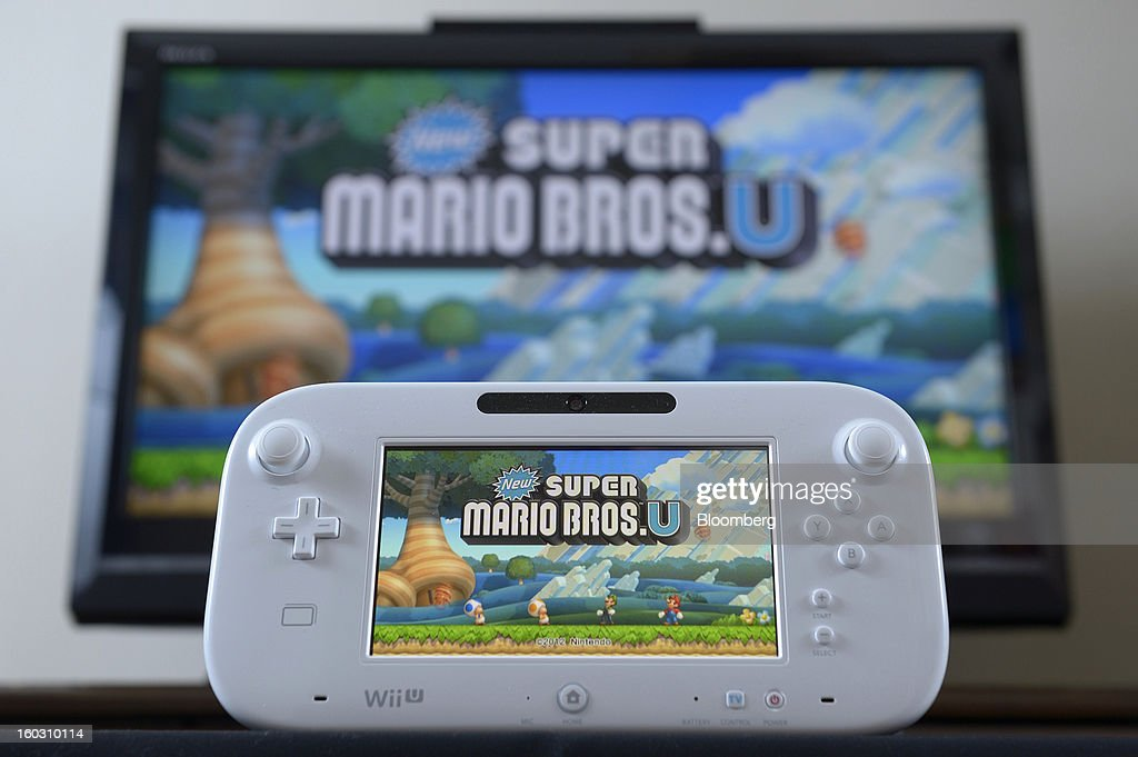 A Nintendo Co. Wii U touch-screen controller displays the new Super Mario Bros. U game in this is arranged photograph in Kawasaki City, Kanagawa Prefecture, Japan, on Tuesday, Jan. 29, 2013. Sony Corp. and Nintendo Co., Japan's biggest makers of gaming devices, rose after China Daily said the world's most-populous country may end a 12-year ban on the sale of video-game consoles. Nintendo, the creator of Super Mario, added 3.4 percent to 9,630 yen, the highest since Dec. 7, in Osaka. Photographer: Akio Kon/Bloomberg via Getty Images