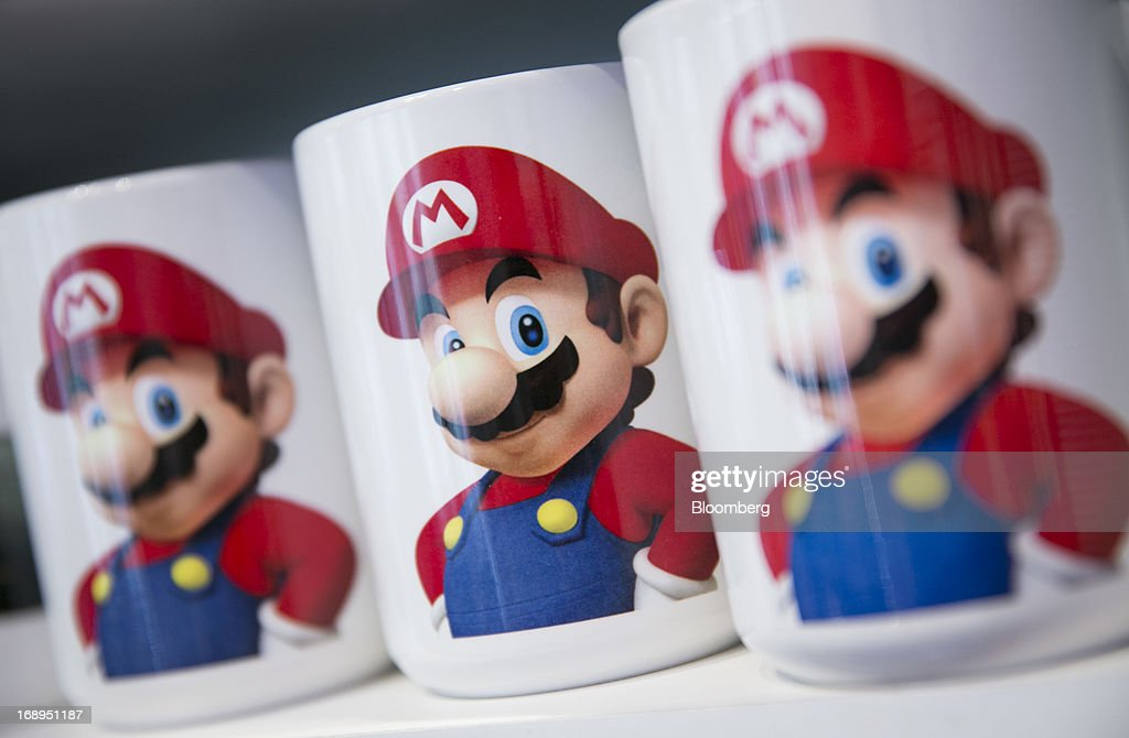 Nintendo Co.'s Super Mario is displayed on coffee mugs for sale at the Nintendo World store in New York, U.S., on Friday, May 17, 2013. Nintendo Co., maker of the Wii video-gaming system, won a U.S. appeals court ruling that makes it harder for patent-licensing companies to seek an import ban on products as a way to demand royalties. Photographer: Scott Eells/Bloomberg via Getty Images
