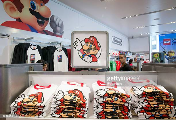 Nintendo Co's Super Mario is displayed on Tshirts for sale at the Nintendo World store in New York US on Friday May 17 2013 Nintendo Co maker of the...