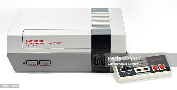 Nintendo Entertainment System video game console and controller photographed on a white background, taken on March 26, 2009.