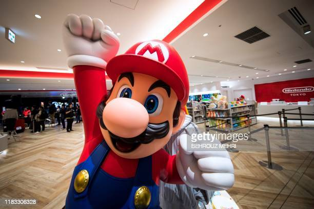 Nintendo game character Mario is seen at a new Nintendo store during a press preview in Tokyo on November 19, 2019. - Nintendo opens the doors this...