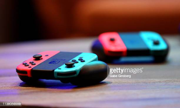 """Nintendo Joy-Con wireless controllers for the Nintendo Switch are displayed during the debut of Allied Esports' """"PlayTime With KittyPlays"""" esports..."""