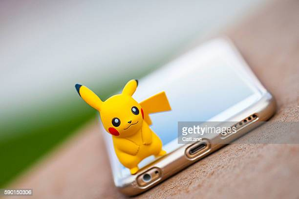 Nintendo Pokemon Go character Pikachu and iPhone