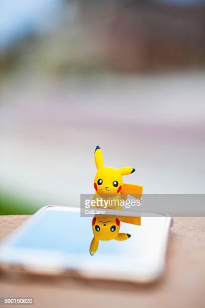 Nintendo Pokemon Go character Pikachu and iPhone