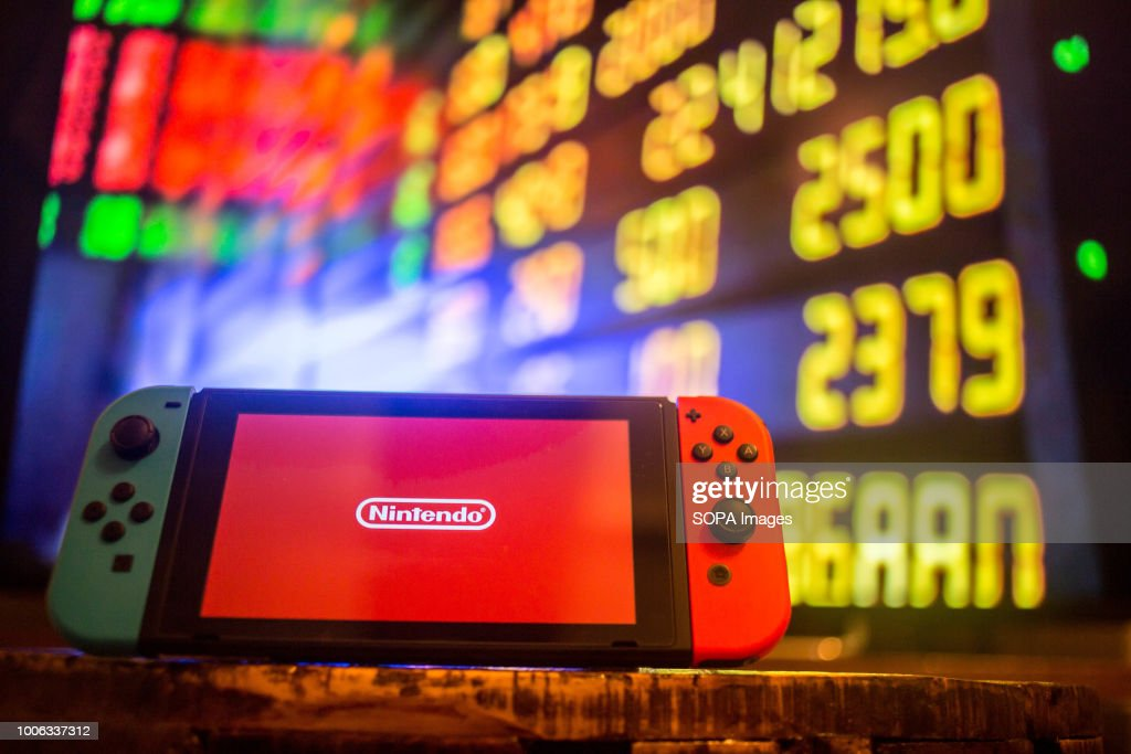 a nintendo switch displays the nintendo logo with a background of a