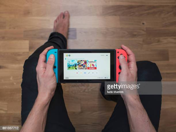 nintendo switch neon game console - nintendo stock pictures, royalty-free photos & images