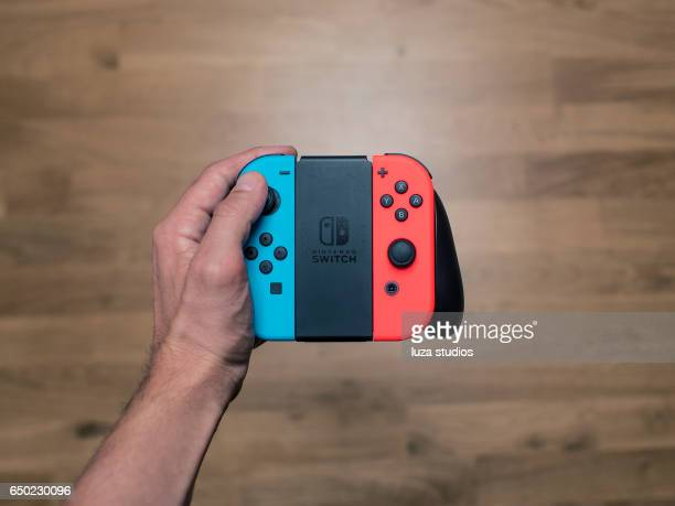 nintendo switch neon game controller - nintendo stock pictures, royalty-free photos & images