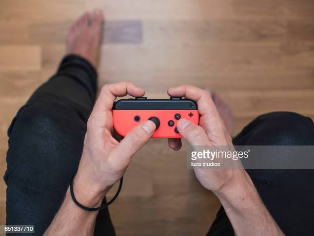 nintendo switch neon game controller - nintendo switch stock pictures, royalty-free photos & images