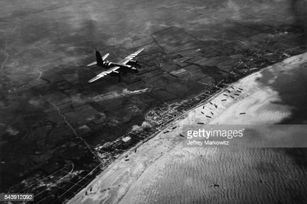 A Ninth Air Force B26 flies over one of the beaches during the invasion of Normandy in June 1944