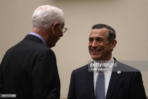Ninth Circuit Appeals Court Judge Carlos Bea talks with US Rep Darrell Issa before the start of a House Judiciary Committee hearing on March 16 2017...