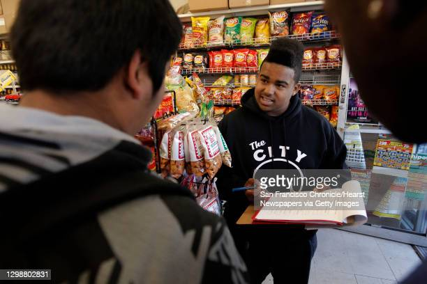 Ninth garder, Christopher Carranza, is surveyed about his shopping habits by fellow student Maurice Ross, at a liquor store along Silver Ave. On...