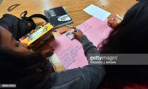 Ninth graders work on their poster projects in the classroom of Health Education teacher Leticia Jenkins at James Monroe High School in North Hills...