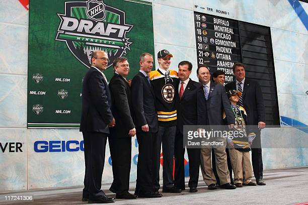 Ninth overall pick Dougie Hamilton by the Boston Bruins stands at the podium for a photo with General Manager Peter Chiarelli former Bruins player...