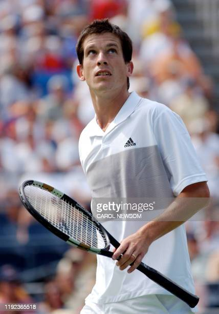 Ninth seed Tim Henman of Great Britain looking skyward during his third round match with Xavier Mailisse of Belgium at the US Open in Flushing...