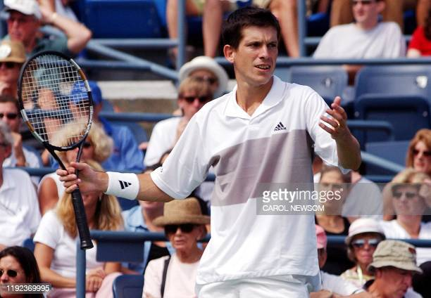 Ninth seed Tim Henman of Great Britain reacts during his upset third round loss to Xavier Malisse of Belgium at the US Open in Flushing Meadows New...