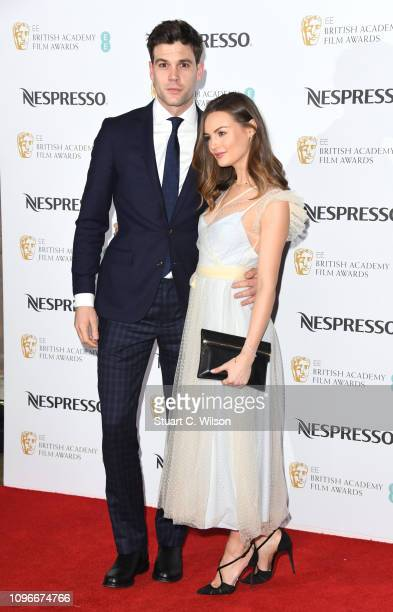 Niomi Smart and Joe Woodward attend the Nespresso British Academy Film Awards nominees party at Kensington Palace on February 9 2019 in London England
