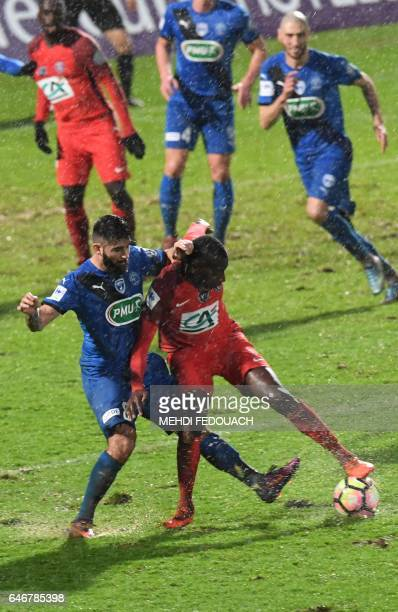 Niort's defender Dylan Bronn vies with Paris SaintGermain's French midfielder Blaise Matuidi during the French Cup football match between Niort and...