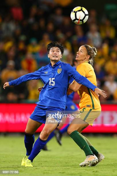 Nipawan Panyosuk of Thailand and Aivi Luik of the Matildas contest a header during the International Friendly Match between the Australian Matildas...