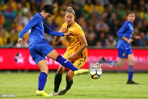 Nipawan Panyosuk of Thailand passes th eball against Aivi Luik of the Matildas during the International Friendly Match between the Australian...