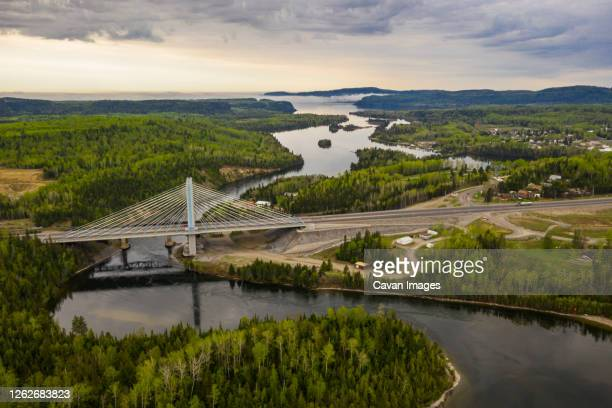 nipigon river bridge overlooking nipigon bay during sunrise - the americas stock pictures, royalty-free photos & images