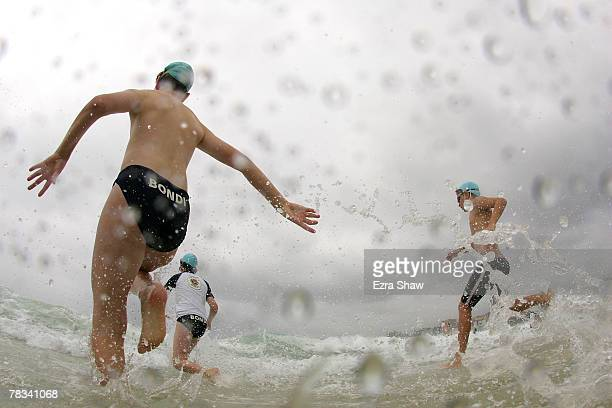 Nippers junior lifesavers run in to the surf for an ocean swim at Bondi Beach on December 9 2007 in Sydney Australia The Bondi Surf Bathers' Life...