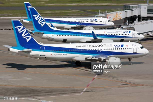 Nippon Airways Airbus 320 parked at Tokyo Haneda airport