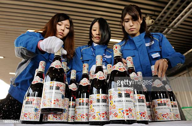 Nippon Express Co employees arrange bottles of Georges Duboeuf Beaujolais Nouveau wine at Haneda Airport in Tokyo Japan on Tuesday Nov 5 2013...