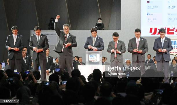 Nippon Ham Fighters assistant general manager Masao Kida pumps his fist after winning a seventeam lottery for the right to select Waseda Jitsugyo...