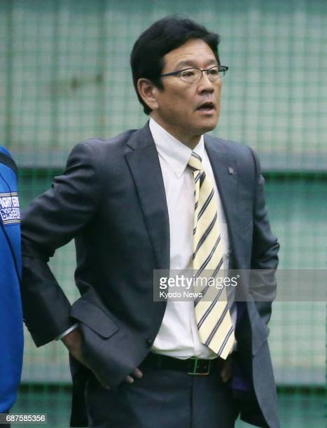 Nippon Ham Fighters manager Hideki Kuriyama observes as his team's slugging ace pitcher Shohei Otani practices at the club's farm team facility in...