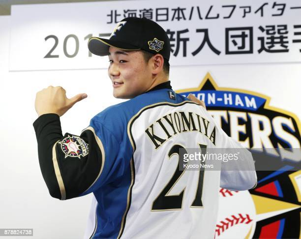 Nippon Ham Fighters No 1 pick Kotaro Kiyomiya displays his jersey during a ceremony in the club's hometown Sapporo on Nov 24 2017 ==Kyodo
