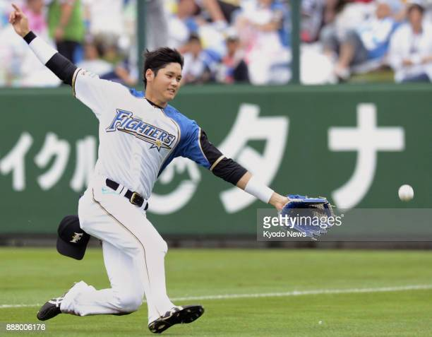 Nippon Ham Fighters outfielder Shohei Ohtani slides to catch the ball during a game in Obihiro Japan in Aug 18 2013 ==Kyodo