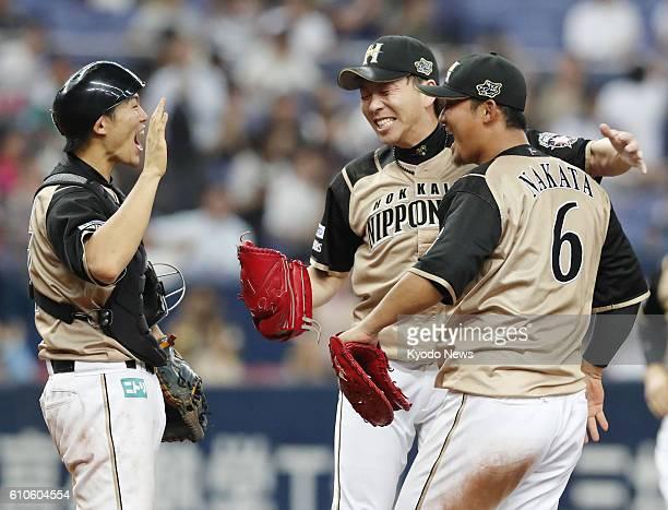 Nippon Ham Fighters pitcher Naoki Miyanishi catcher Shota Ono and first baseman Sho Nakata celebrate their 43 victory over the Orix Buffaloes at...