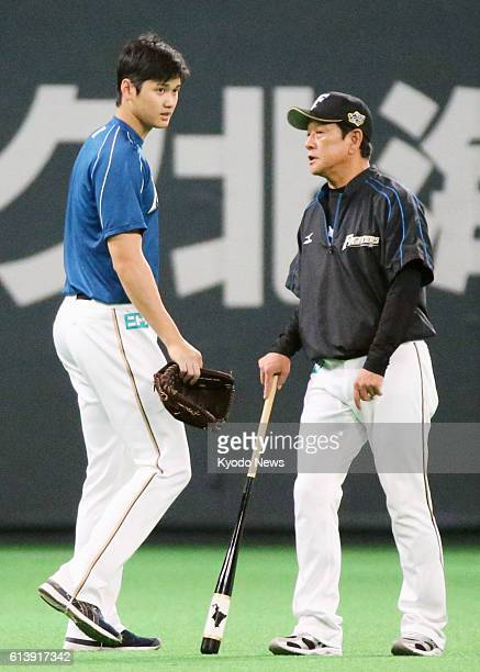 Nippon Ham Fighters pitcher Shohei Otani and manager Hideki Kuriyama take part in the team's workout at Sapporo Dome on Oct 11 the eve of Game 1 of...
