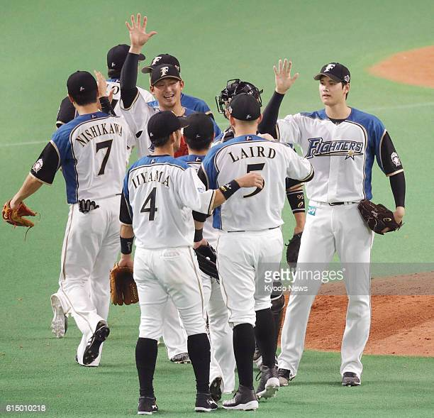 Nippon Ham Fighters pitcher Shohei Otani celebrates with his teammates after beating the SoftBank Hawks 74 in Game 5 of the Pacific League Climax...