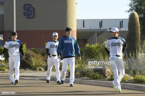 Nippon Ham Fighters pitcherdesignated hitter Shohei Otani heads to a photo session in Peoria Arizona on Feb 1 the first day of the team's training...