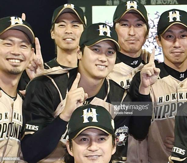 Nippon Ham Fighters pitcherslugger Shohei Ohtani poses with teammates after winning the Japan Series at Mazda Stadium in Hiroshima in October 2016...