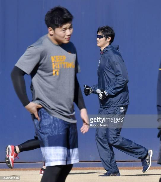 Nippon Ham Fighters rookie Kotaro Kiyomiya and Los Angeles Angels new signing Shohei Ohtani train at the Fighters' facility in Kamagaya Chiba...