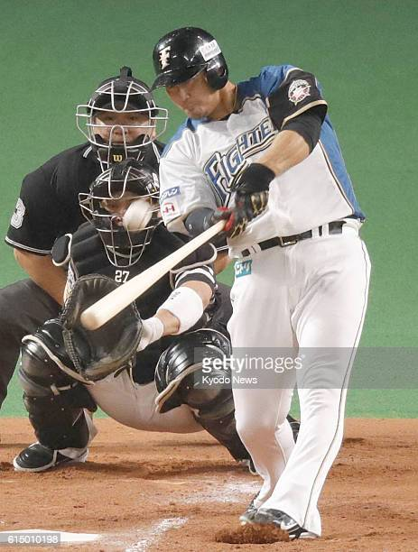 Nippon Ham Fighters slugger Sho Nakata hits a home run over the leftfield fence in the second inning of a game against the SoftBank Hawks in Game 5...