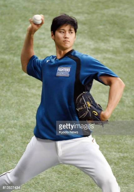 Nippon Ham Fighters' slugging ace pitcher Shohei Otani trains on July 11 at Kyocera Dome the day before he is set to return to the mound with the...
