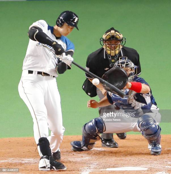 Nippon Ham Fighters superstar Shohei Otani doubles during the third inning of the seasonopening game against the Seibu Lions at Sapporo Dome on March...