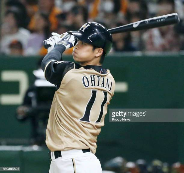 Nippon Ham Fighters twoway player Shohei Otani hits the ball in a preseason game against the Yomiuri Giants at Tokyo Dome on March 23 2017 The...