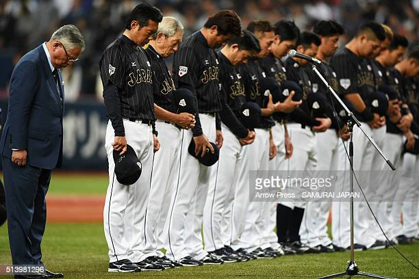 Nippon Professional Baseball Commissioner Katsuhiko Kumazaki players and coaching staffs observe a minute of silence for the victims of the Great...