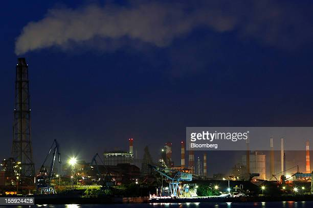Nippon Steel & Sumitomo Metal Corp.'s Kashima works stands illuminated at night in Kashima City, Ibaraki Prefecture, Japan, on Thursday, Nov. 8,...