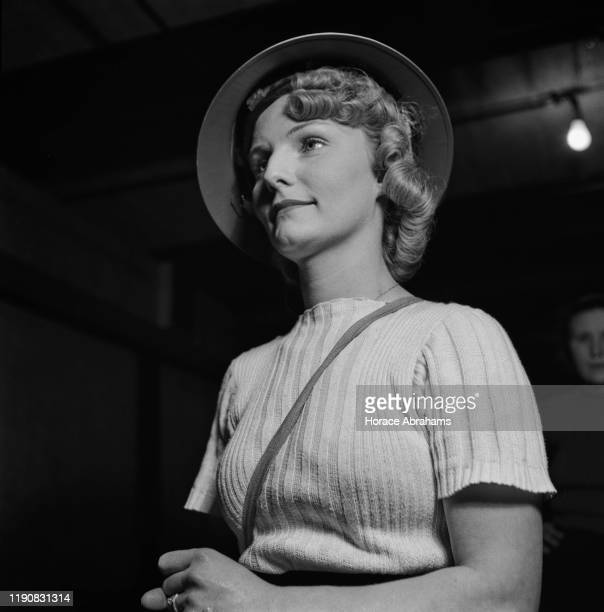 A 'nippy' or waitress at a J Lyons Co tea shop in London getting dressed for her fire watch duty during World War II March 1941 She will look out for...