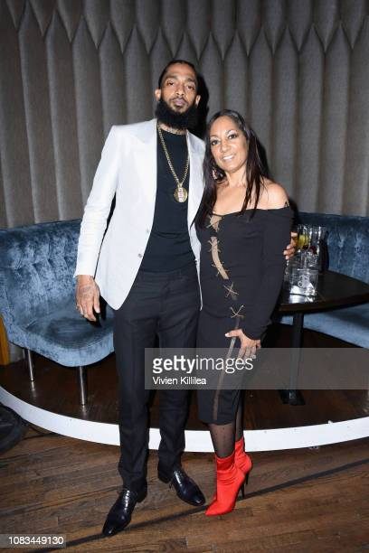 Nipsey Hussle and his mother attend the PUMA x Nipsey Hussle 2019 Grammy Nomination Party at The Peppermint Club on January 16 2019 in Los Angeles...