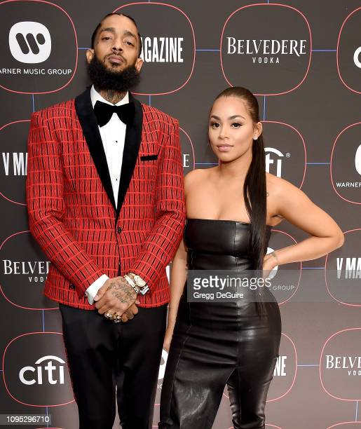 Nipsey Hussle and Lauren London arrive at the Warner Music Group PreGrammy Celebration at Nomad Hotel Los Angeles on February 7 2019 in Los Angeles...