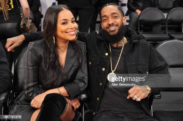 Nipsey Hussle and Lauren London attend a basketball game between the Los Angeles Lakers and the Portland Trail Blazers at Staples Center on November...